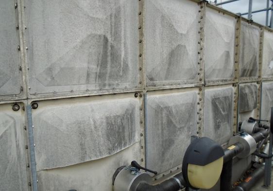 GRP water tank showing weather damage